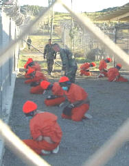 20060605215322-21-prisioneros-dos-guantanamo-200102-20reuters.jpg